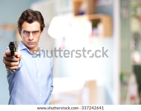 angry young man with pop gun