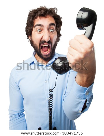 angry young man with telephone - stock photo