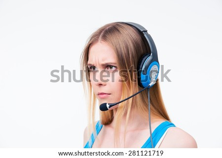 Angry young woman assistant operator in headset isolated on a white background. Looking away - stock photo