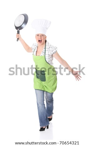 Angry young woman cooking , isolated on white - stock photo