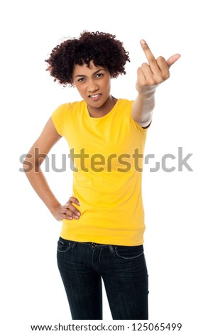 Angry young woman making obscene hand gesture.