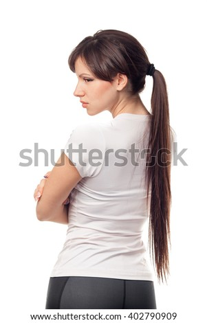 Angry young woman with crossed arms on white background - stock photo