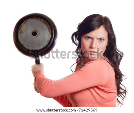 Angry young woman with rage in face and saucepan in one hand - stock photo