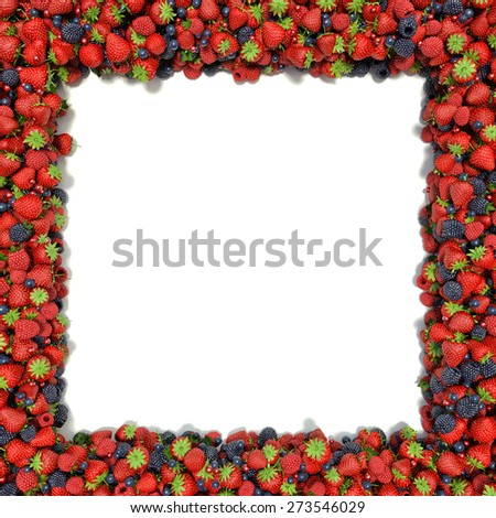 angular frame of juicy, ripe strawberries, blueberries, raspberries and blackberries on a white background. space for text on the left - stock photo