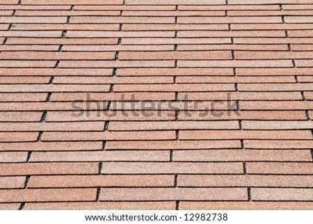 Angular overlapped roof shingles as a background - stock photo