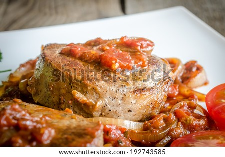 Angus Beef Steaks With Roasted Tomato Sauce - stock photo