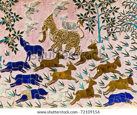 Animal Mosaics on the Old Buddhist Temple of Wat Xieng Thong in Luang Prabang, Laos - stock photo