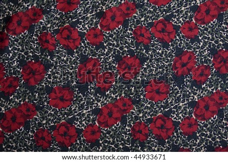Animal print and flowers fabric background. Full frame. - stock photo