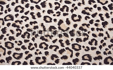 Animal print, leopard pattern fabric background in brown colors. - stock photo