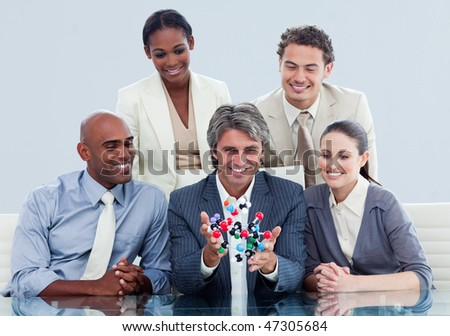 Animated business team showing a molecule in a meeting