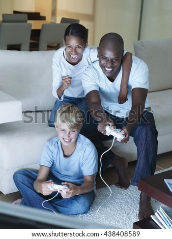 Animated family playing video game - stock photo