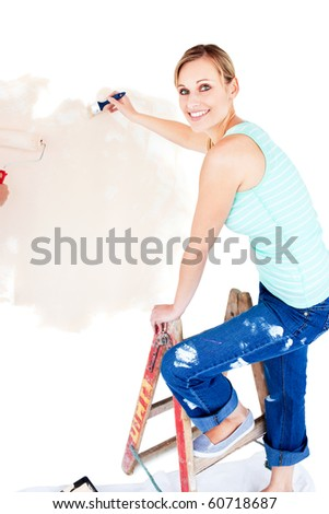 Animated woman painting a room in her new house - stock photo