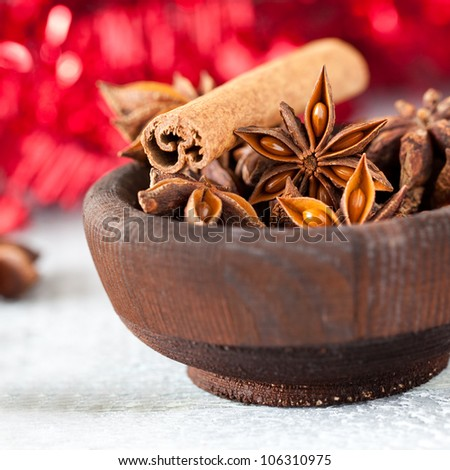 anise and cinnamon in a bowl for christmas - stock photo