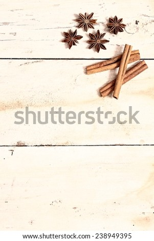 anise and cinnamon on white wooden table - stock photo
