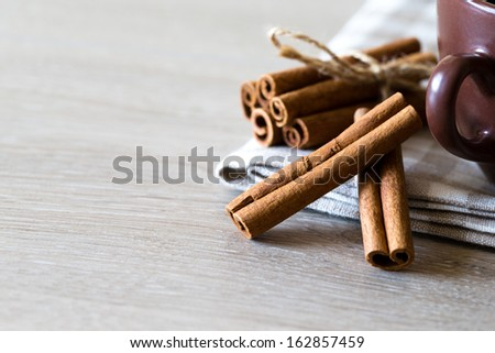 anise and cinnamon, on wooden table  - stock photo