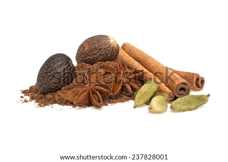Anise, cardamom, nutmeg and cinnamon sticks on a white background - stock photo