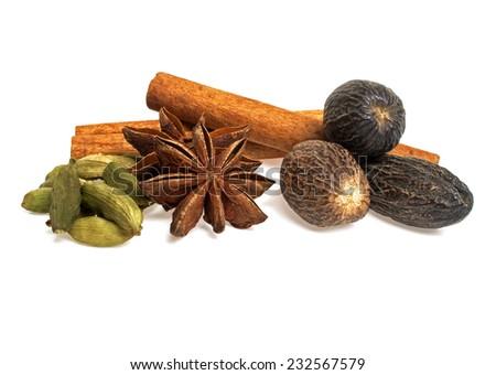 Anise, cardamom, nutmeg and cinnamon sticks on a white background. Spices. - stock photo