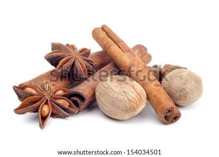 anise, nutmeg and cinamon isolated on white background - stock photo