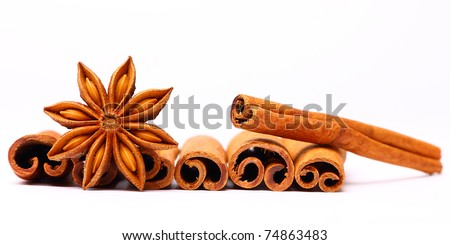 Anise star and several cinnamon sticks isolated - stock photo