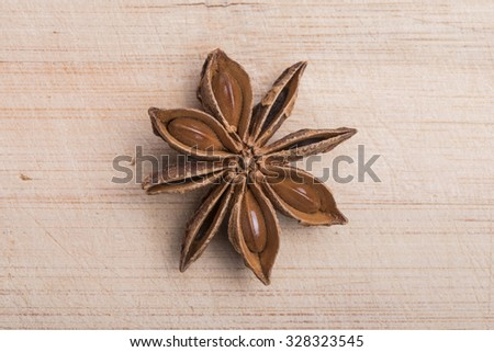 Anise star on wooden background - stock photo