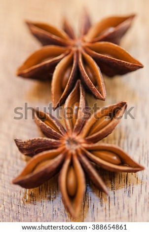 anise stars on a wood background closeup - stock photo