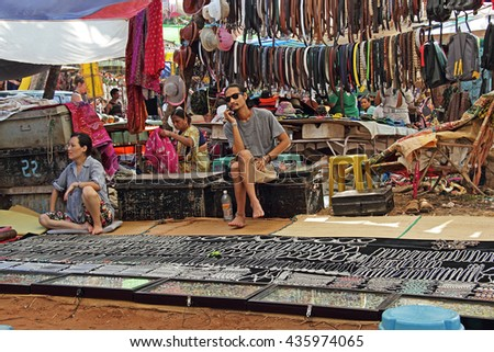 Anjuna Beach, Goa, India - November 25, 2015 - Shops and customers at the Wednesday flea market selling varieties of merchandise.