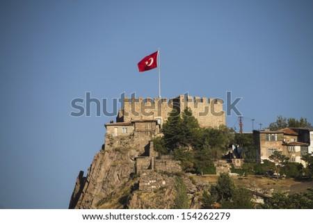 Ankara castle with Turkish flag, Ankara, Turkey. - stock photo