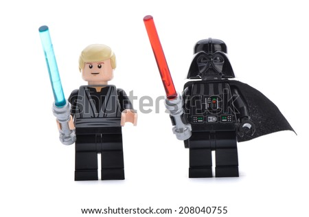 Ankara, Turkey - April 06, 2013: Close up of a Lego Star Wars Darth Vader and Luke Skywalker with lightsaber swords isolated on white background. - stock photo