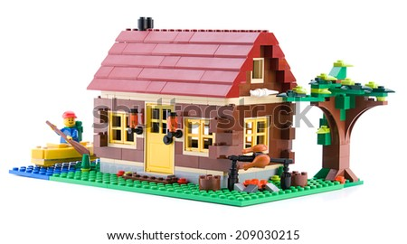 Ankara, Turkey - April 15, 2012: Lego Creator - Log Cabin is a 3 in 1 countryside houses packed with great details isolated on white background - stock photo