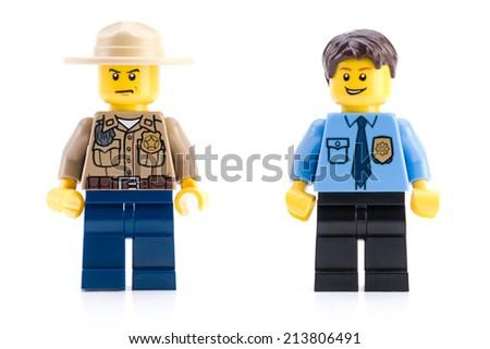 Ankara, Turkey - April 04, 2012 : Lego police minifigures isolated on white background. - stock photo