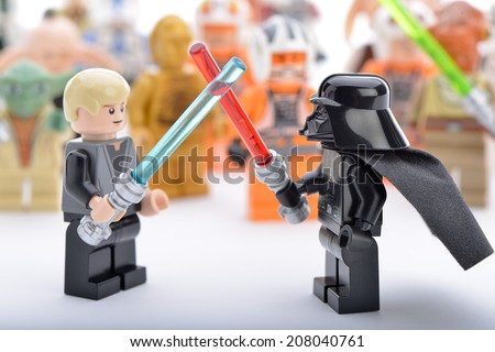Ankara, Turkey - April 06, 2013: Lego Star Wars Darth Vader and Luke Skywalker are fighting with sword in front of Star Wars characters  - stock photo