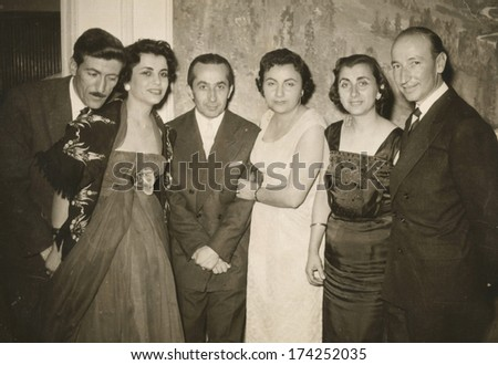 ANKARA, TURKEY-CIRCA 1955 - Some friends with husbands and wifes posing to camera. Circa 1950's - stock photo