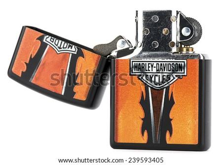Ankara, Turkey - December 10, 2014:  Zippo reusable metal lighter with Harley Davidson theme on isolated on white background.  - stock photo