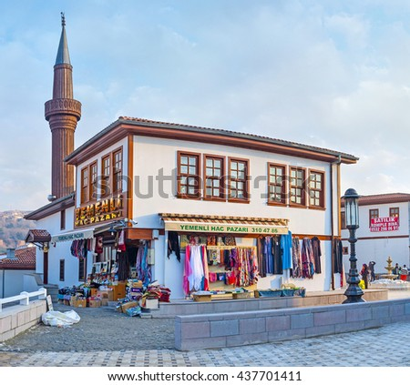 ANKARA, TURKEY - JANUARY 16, 2015: The  scenic cottage of the modern neighborhood in old town with the wooden minaret on the background, on January 16 in Ankara.