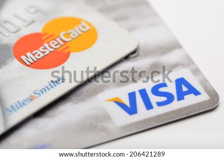 Ankara, Turkey - October 17, 2012 : Studio shot of two major credit cards Visa and MasterCard over white background  - stock photo