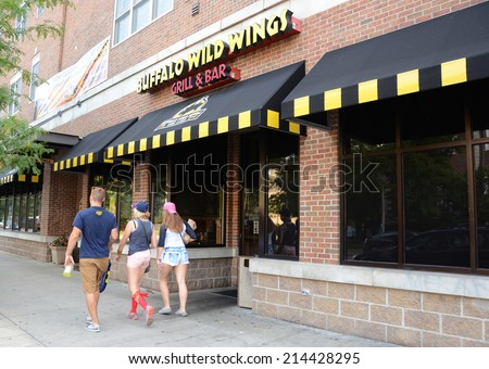 ANN ARBOR, MI - AUGUST 30: Buffalo Wild Wings, whose downtown Ann Arbor store is shown on August 30, 2014, served more than 7.7 million chicken wings.  - stock photo