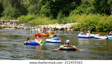 ANN ARBOR, MI - AUGUST 3: Kayakers enjoy the rapids at the Argo Cascades in Ann Arbor, MI on August 3, 2014. - stock photo