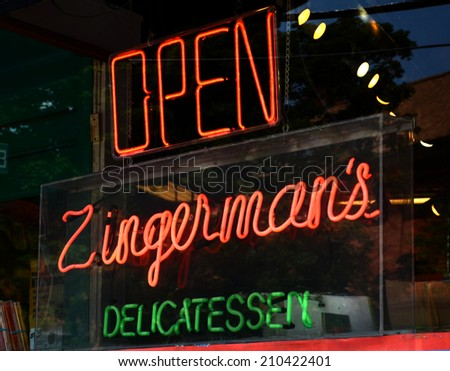 ANN ARBOR, MI - AUGUST 3: Neon sign in Zingerman's deli window in Ann Arbor, MI on August 3, 2014.  Zingerman's co-owner Paul Saginaw has lobbied to increase the minimum wage. - stock photo