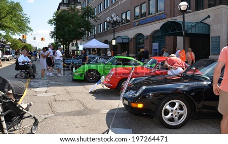 ANN ARBOR, MI - JULY 12: 1996, 1964, and 1995 Porsches at the Rolling Sculpture car show  July 12, 2013 in Ann Arbor, MI - stock photo
