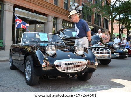 ANN ARBOR, MI - JULY 12: 1960 Austin Healey Sprite at the Rolling Sculpture car show  July 12, 2013 in Ann Arbor, MI. - stock photo