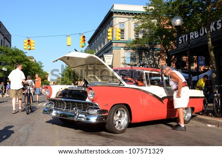 ANN ARBOR, MI - JULY 13: 1956 Ford Fairlane at the Rolling Sculpture car show July 13, 2012 in Ann Arbor, MI. - stock photo