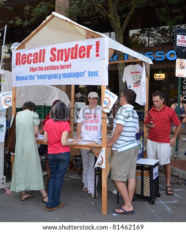 ANN ARBOR, MI - JULY 22: Supporters of an effort to recall Michigan Governor Rick Snyder staff a booth to gather petition signatures at the Ann Arbor Art Fair in Ann Arbor, MI  July 22, 2011.