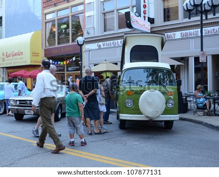 ANN ARBOR, MI - JULY 13: Volkswagen camper at the Rolling Sculpture car show July 13, 2012 in Ann Arbor, MI. - stock photo