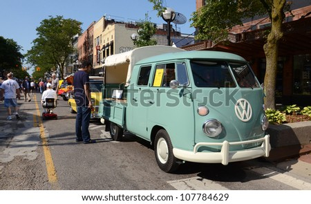 ANN ARBOR, MI - JULY 13: 1964 Volkswagen Double Cab pick-up at the Rolling Sculpture car show July 13, 2012 in Ann Arbor, MI. - stock photo