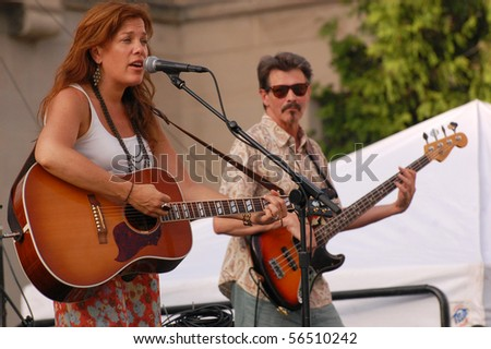 ANN ARBOR, MI - JUNE 20: Jill Jack of Jill Jack Band performs at the Ann Arbor Summer Festival June 20, 2010 in Ann Arbor, MI - stock photo