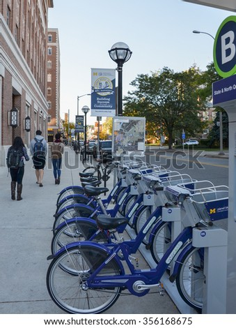 ANN ARBOR, MI - OCTOBER 10: ArborBike rental stations, such as the one shown here in Ann Arbor, MI on October 10, 2015, was inaugurated in September 2014.  - stock photo