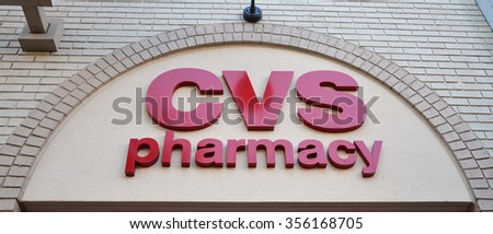 ANN ARBOR, MI - OCTOBER 10: CVS Pharmacy, whose downtown Ann Arbor, MI store logo is shown on October 10, 2015, has over 7,600 stores. - stock photo