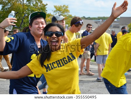ANN ARBOR, MI - SEPTEMBER 26: University of Michigan football fans enter the stadium before the BYU game on September 26, 2015. Michigan lost the game 0-31. - stock photo