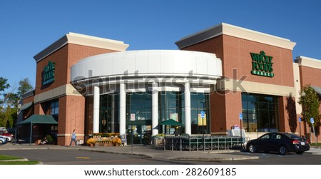 ANN ARBOR, MI - SEPTEMBER 7: Whole Foods, whose east Ann Arbor store logo is shown on September 7, 2014, has over 360 stores in North America and the United Kingdom.  - stock photo