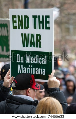 ANN ARBOR, MICHIGAN - APRIL 2: An unidentified protester holds up at sign at the 40th annual Hash Bash at the University of Michigan campus on Saturday, April 2, 2011 in Ann Arbor, Michigan. Several thousand people attended the event. - stock photo